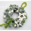 Fehér-zöld karácsonyi ajtókoszorú fehér toboz alapon
